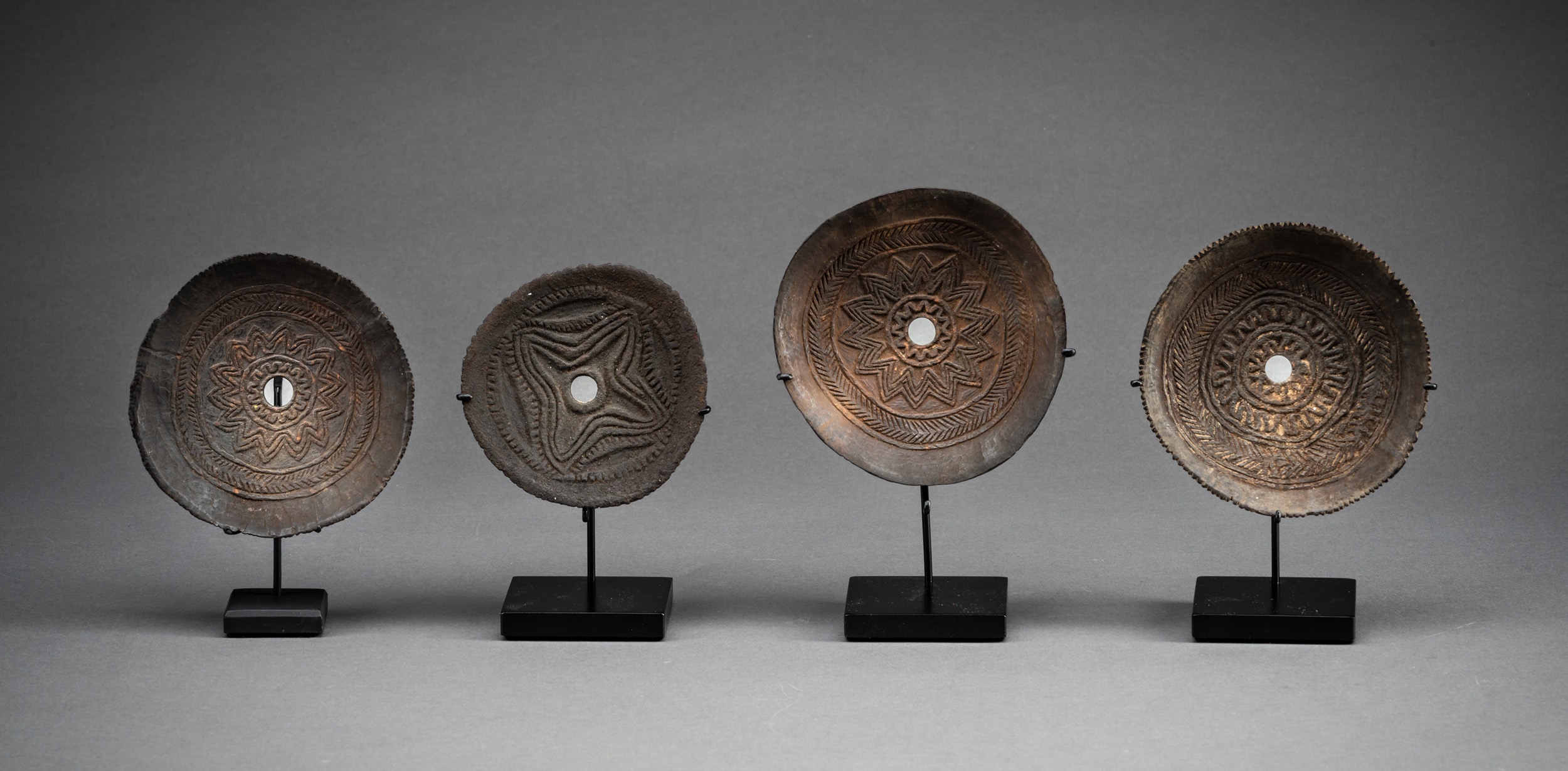 A Collection of Four Abelam Coconut Spining Tops, East Sepik Province, Papua New Guinea, Early 20th Century