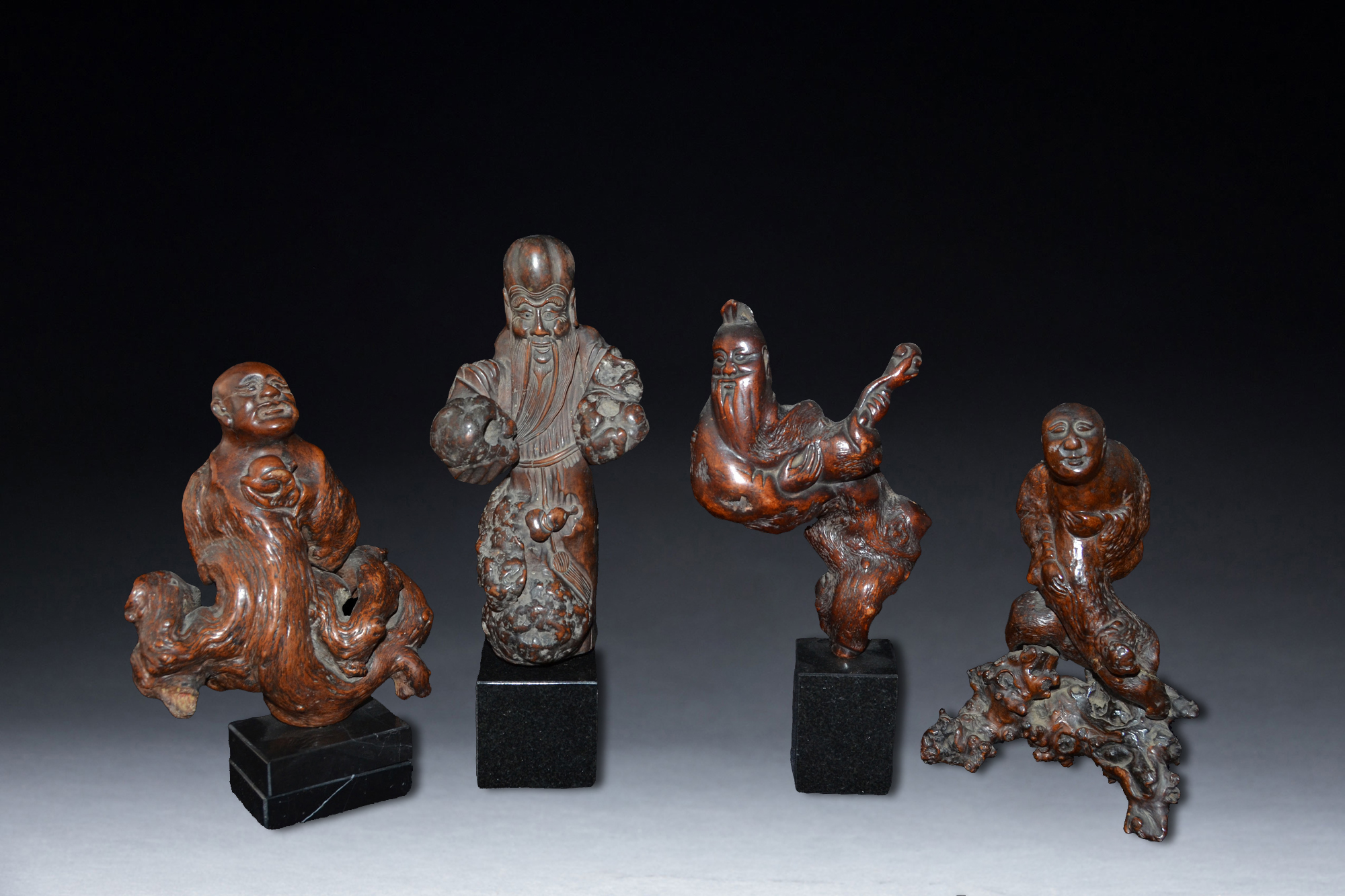 Four Carved Burlwood Figures of Lohan China 19th Century